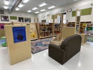 children's learning area - toy and book area with couch